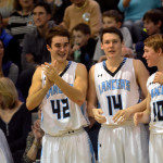 Senior Luke Ehly and Juniors Stanely Morantz and Connor Reig cheer on their teammates from the bench.  Photo by Tess Iler
