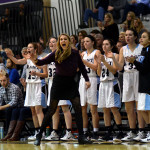 Head Coach Lauren Lawrence and the SME bench cheer after Kyle Haverty scores an open layup.  Photo by Tess Iler