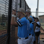 Varsity baseball players watch the play from the dugout. Photo by Audrey Kesler
