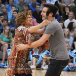 "Judge Mrs. Rasmussen hugs junior Jacob DeSett after he chose to join her team during the Pep Club's ""The Voice"" competition. Photo by Haley Bell"