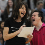 "Freshman Jack Melvin and teacher Ms. Schnakenberg laugh at their joke while hosting ""The Voice"" competition. Photo by Haley Bell"