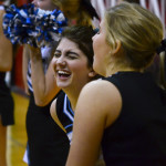 Junior cheerleaders Lily Horton and Emma Stanford laugh before the game. Photo by Diana Percy