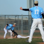 Senior Spencer Mustoe tags runner on third base Photo by Carson Holtgraves