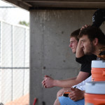 Managers Charlie Jensen and Jay Guastello watch the team from the dugout. Photo by Katie Lamar