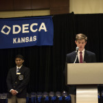 Junior Chace Prothe delivered his speech for Kansas DECA Vice President. Photo by Claire Pottenger