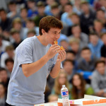 Sophomore John John Rooney eats a donut during the class competition.  Photo by Tess Iler