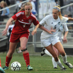 Senior Elizabeth Shook attempts to take the ball from a Shawnee Mission North player. Photo by Haley Bell