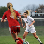 Senior Chloe Harrington looks for an opening to pass her defender. Photo by Haley Bell