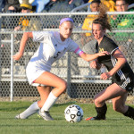 Senior Elizabeth Shook competes for possession of the ball. Photo by Haley Bell