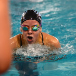 Sophomore Grace Apodaca swims breaststroke in a relay. Photo by Ellie Thoma