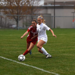 Senior Elisabeth Shook fights opponent for the ball. Photo by Michael Kraske