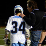 Head Coach Will Garrett congratulates Senior Henry Redmond on his goal. Photo by Kaitlyn Stratman