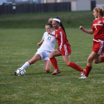 Senior Chloe Harrington pushes off a North defender. Photo by Michael Kraske