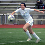 Sophomore Katie Hise focuses across the field as she prepares to pass the ball. Photo by Kaitlyn Stratman