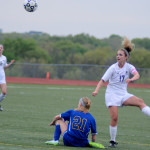 Senior Chloe Harrington pops the ball up before her opponent can slide in to take it. Photo by Kaitlyn Stratman