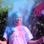 Freshmen Gia Hense cringes as color is thrown at her. Photo by Ellie Thoma