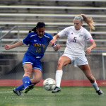 Senior Elisabeth Shook and her opponent battle for the ball as they approach the goal. Photo by Kaitlyn Stratman