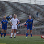 Both teams watch as Senior Georgia Weigel makes her penalty kick, adding to East's lead. Photo by Kaitlyn Stratman
