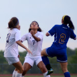Senior Georgia Weigel focuses on the ball, ready to settle it when it comes down. Photo by Kaitlyn Stratman