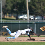 Junior Clayton Phillips dives to first base to avoid being picked off. Photo by Joseph Cline