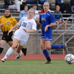 Junior Josie Clough races to beat the other team to the ball. Photo by Morgan Browning
