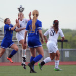 Senior Chloe Harrington heads the ball when it's passed to her. Photo by Morgan Browning