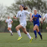 Freshman Izzy Rapp sprints down the field during the first half of the game. Photo by Morgan Browning