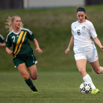Freshman Izzy Rapp runs down the field while defending the ball. Photo by Morgan Browning