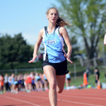 Sophomore Madeline Stump runs the 100m dash.  Photo by Tess Iler
