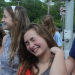Sophomore Isabelle Cunningham laughs with her friends while waiting at a stop light. Photo by Anna Kanaley