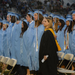 Lancers sing their last school song before becoming East alumni. Photo by Daisy Bolin