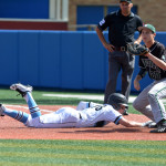Junior Jake Randa dives for safety  back to first base. Joseph Cline