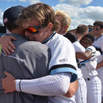 Junior Jake Randa ecstatically embraces teammates after the game. Photo by Joseph Cline