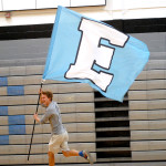 "Senior and yell leader Brayton Bowers leads the flag line with the ""E"". Photo by Caroline Mills"