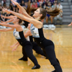 Junior Savanna Worthington drops to the splits during the Varsity Lancer Dancer routine. Photo by Audrey Kesler
