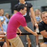 Sophomore Jack Melvin helps the football team during the tug-of-war. Photo by Caroline Mills