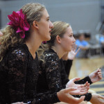 "Sophomores Olivia Caponecchi and Piper Noblit cheer on the Varsity Lancer Dancers. JV Captain Maggie Mulligan says ""I think JV has a really great bond so far...I can definitely see us getting closer with each practice."" Photo by Caroline Mills"