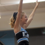 Sophomore Carolyn Simpson flies above her sophomore classmates on their way into the gym. Photo by Caroline Mills