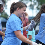 Freshman Megan Devolder helps Claire Evans clean a car at the theater carwash. Photo by Katherine Odell