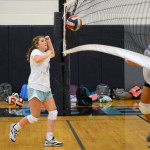 Sophomore Maggie Scott prepares to spike the ball, but it hits the net. Photo by Diana Percy