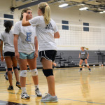 Sophomore Amanda Anderson wipes sweat off of sophomore Maggie Scott's face during tryouts. Photo by Diana Percy