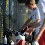 Sophomore Cooper Holmes packs his bag before the team huddled up at the end of tryouts. Photo by Kaitlyn Stratman