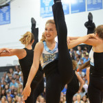 Senior varsity lancer dancer Gretchen Crum kicks her leg while performing team dance at the fall pep assembly. Photo by Katherine Odell