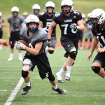Sophomore Garrett Boschen runs to get a touchdown during the second half of the scrimmage. Photo by Morgan Browning