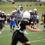 Sophomore Andy Maddox throws a pass during the second half of the scrimmage. Photo by Morgan Browning
