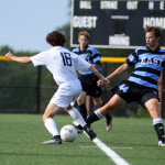 Senior Will Krebs tires to keep his defender from gaining possesion of the ball. Photo by Ellen Swanson