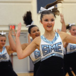 Junior Savannah Worthington flashes a quirky smile during the Varsity Lancer Dancer performance. Photo by Annie Lomshek