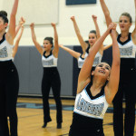 Sophomore and Junior Varsity Lancer Dancer Maggie Mulligan raised her arms during her solo of the performance. Photo by Annie Lomshek