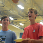 Freshmen Will Harding and Hudson Carroll keep their eyes on the pancake tossed by the pancake-maker. Photo by Annie Lomshek