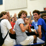 Freshmen Peter Kohring, TJ Libeer, and their teammates cheered as the Drum Line made their entrance. They finished their first practice with Boys JV Soccer that morning and promptly made their way to the breakfast afterwards. Photo by Annie Lomshek